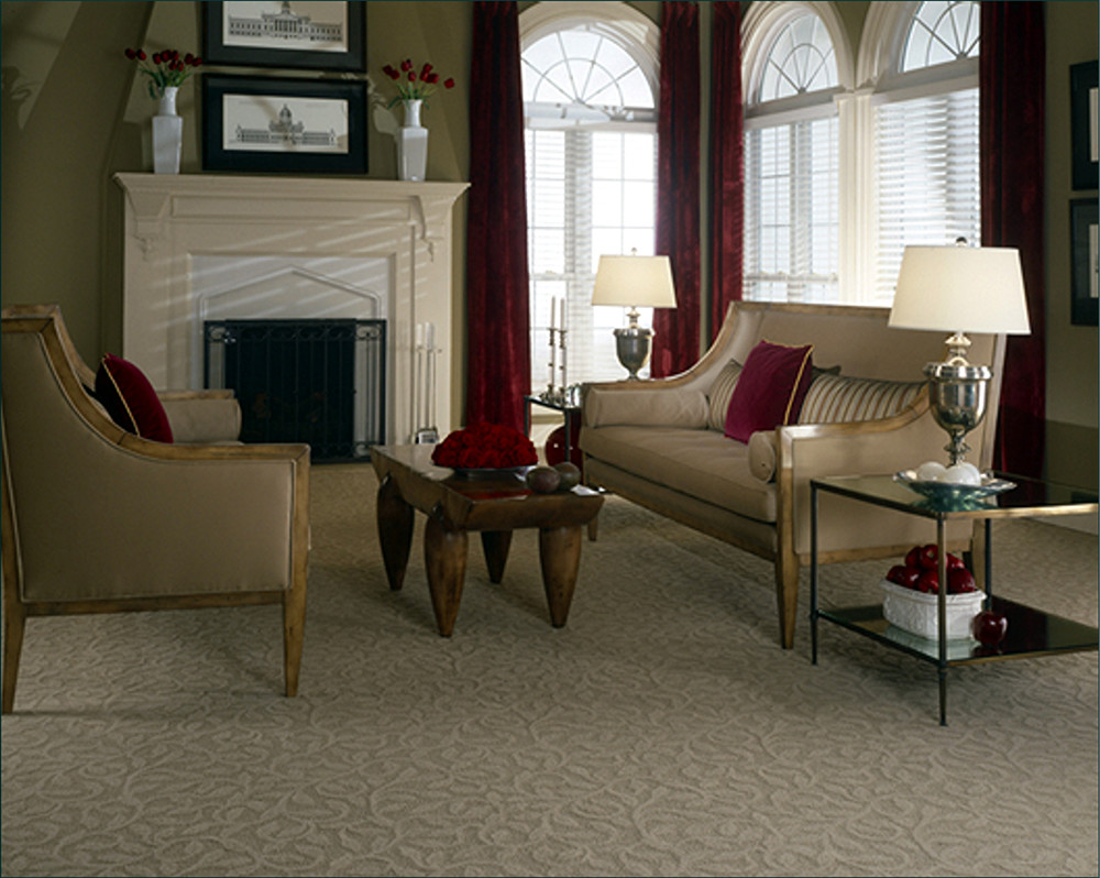 A well-carpeted living room with nice furniture