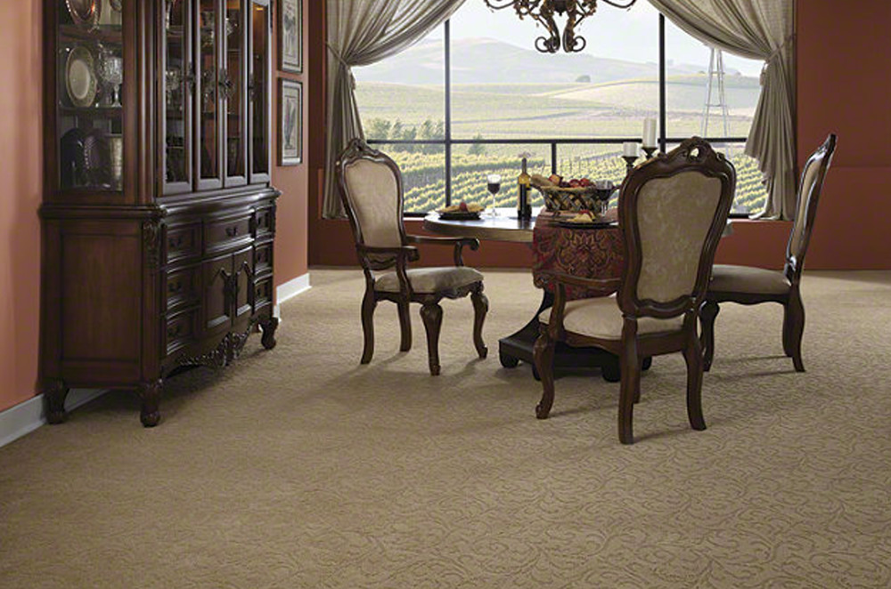A classic-looking dining room with very nice beige carpeting