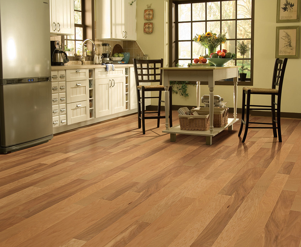 a cozy kitchen with pine laminate flooring