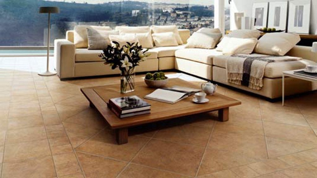 a beautiful living room with matte finished sandstone tiled floor